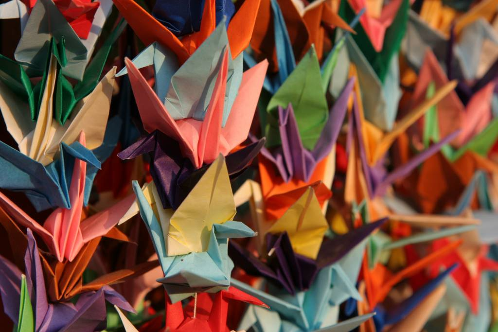 Strings of colorful origami cranes from a Kyoto temple.